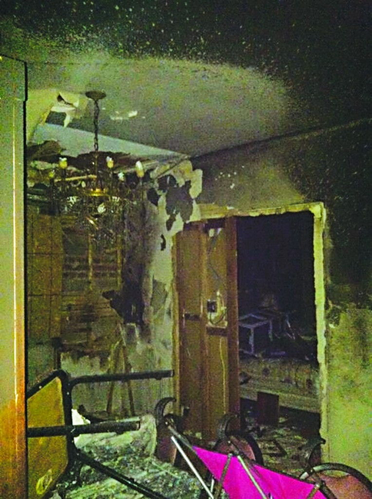 The dining room, where the fire started. It doubled as a guest bedroom for the visiting grandchildren. A toy double stroller, bought specially for Yom Tov, is visible in the foreground.