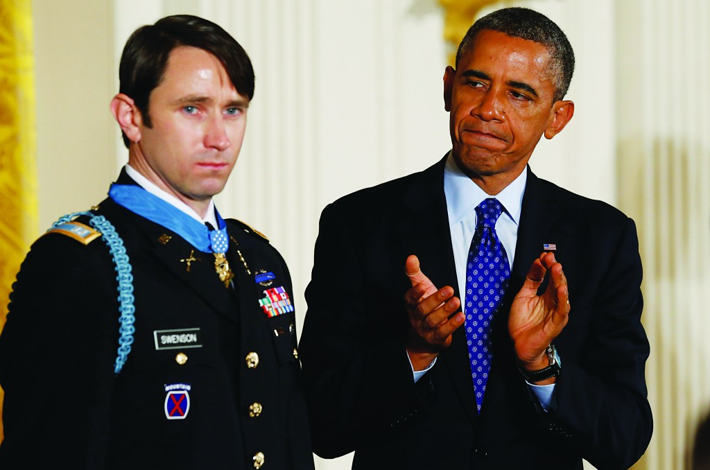 President Obama applauds after awarding William Swenson, a former active duty Army Captain, the Medal of Honor for conspicuous gallantry, in the East Room of the White House in Washington  (REUTERS/Jason Reed)