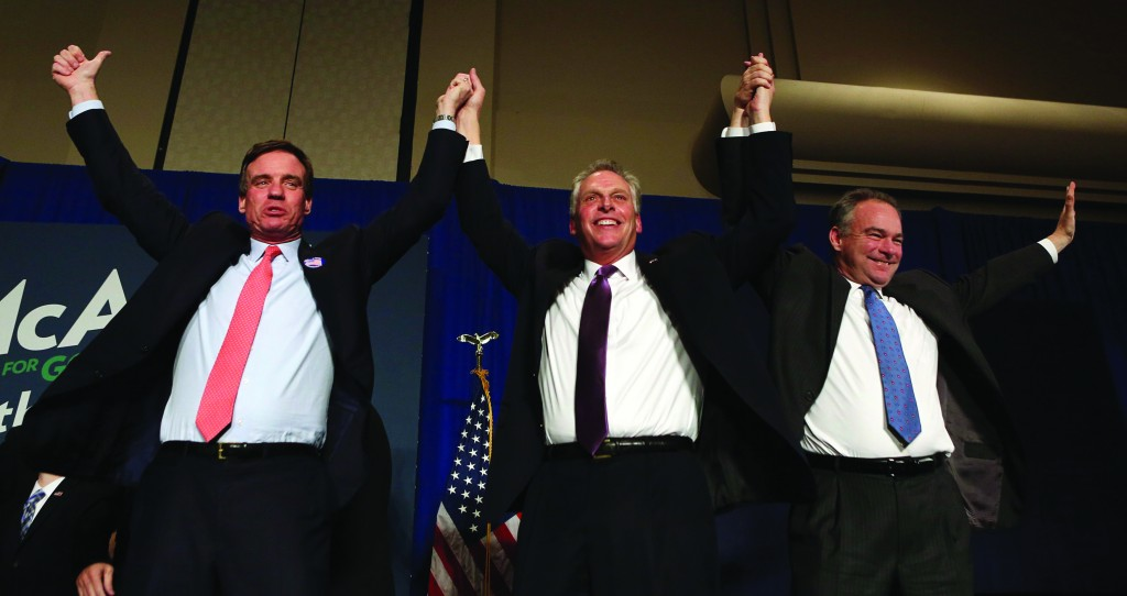 Virginia Democratic governor-elect Terry McAuliffe celebrates with U.S. Senators from Virginia Mark Warner (L) and Tim Kaine (R) at an election night victory rally in Tyson's Corner, Virginia. McAuliffe defeated Republican candidate Ken Cuccinelli in today's governor's election in Virginia. (REUTERS/Gary Cameron)