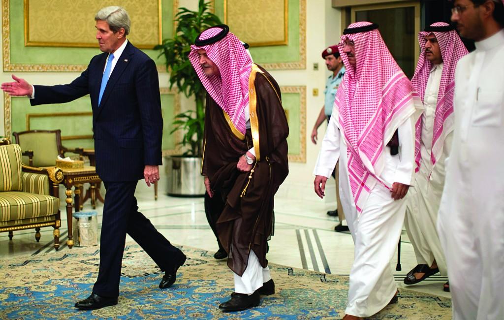 U.S. Secretary of State John Kerry (L) is greeted by Saudi Foreign Minister Prince Saud Al-Faisal bin Abdulaziz al-Saud after arriving in Riyadh, Saudi Arabia, Sunday. (AP Photo / Jason Reed, Pool)