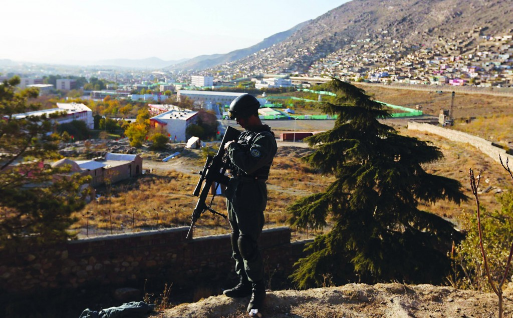 An Afghan policeman keeps watch near the area for the Loya Jirga, which will take place later this week, in Kabul. (REUTERS/Omar Sobhani)