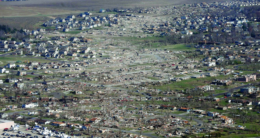 This aerial view on Monday shows the path of a tornado that hit the western Illinois town of Washington on Sunday. It was one of the worst-hit areas after intense storms and tornadoes swept through Illinois. (AP Photo/Charles Rex Arbogast)