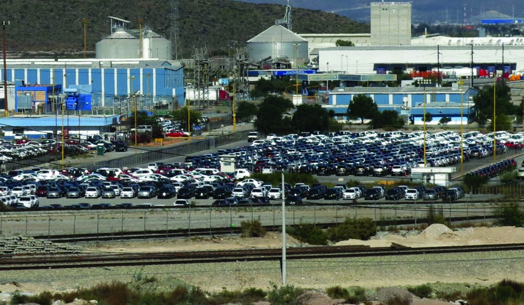 Cars sit at the General Motors plant where Chevrolet Sonics, Cadillac SRXs and Captiva SUVs are assembled in Ramos Arizpe, Mexico. (AP Photo/Marco Ugarte)