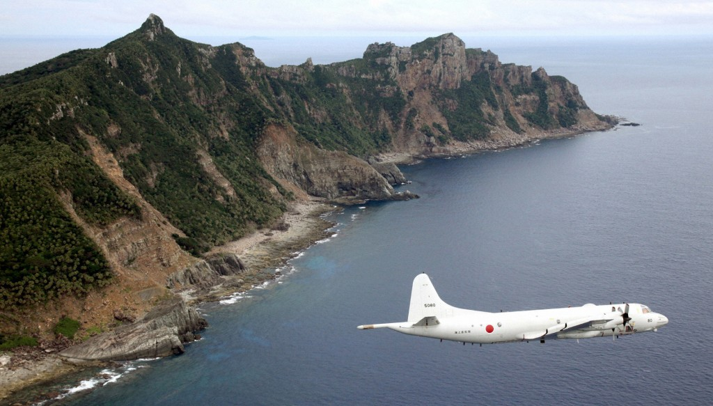 Japan Maritime Self-Defense Force's PC3 surveillance plane flies around the disputed islands in the East China Sea, known as the Senkaku isles in Japan and Diaoyu in China. (REUTERS/Kyodo/Files)