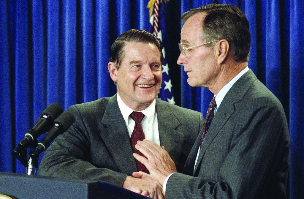 Then-President George H.W. Bush (R) shakes hands with CIA director William Webster after announcing Webster's retirement at the White House, May 8, 1991, in Washington. (FILE PHOTO/AP Photo/Barry Thumma)