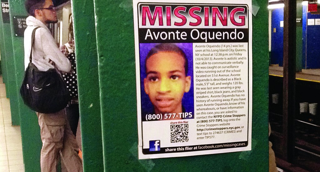 A poster on Thursday asks for help in finding Avonte Oquendo at a Brooklyn subway station. (AP Photo/Barbara Woike)