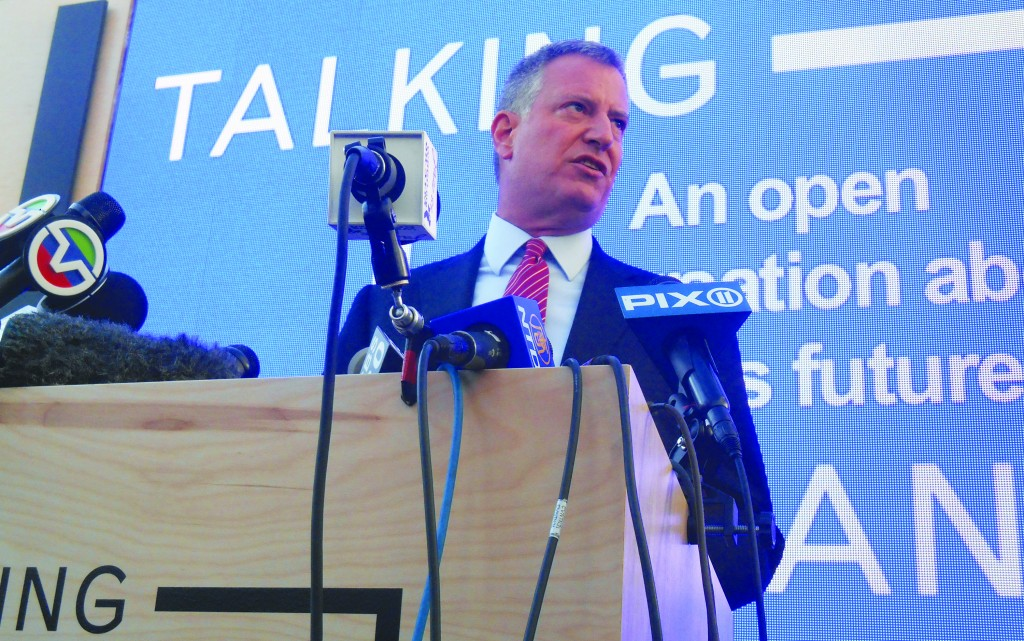 """Mayor-elect Bill de Blasio speaks Wednesday at the """"Talking Transition"""" tent set up in Manhattan, unveiling his list of 60 transition team members. (Ross Barkan/Politicker)"""