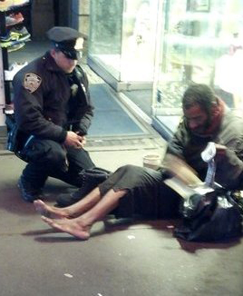 Officer Lawrence DePrimo giving a pair of boots for Jeffrey Hillman last year.