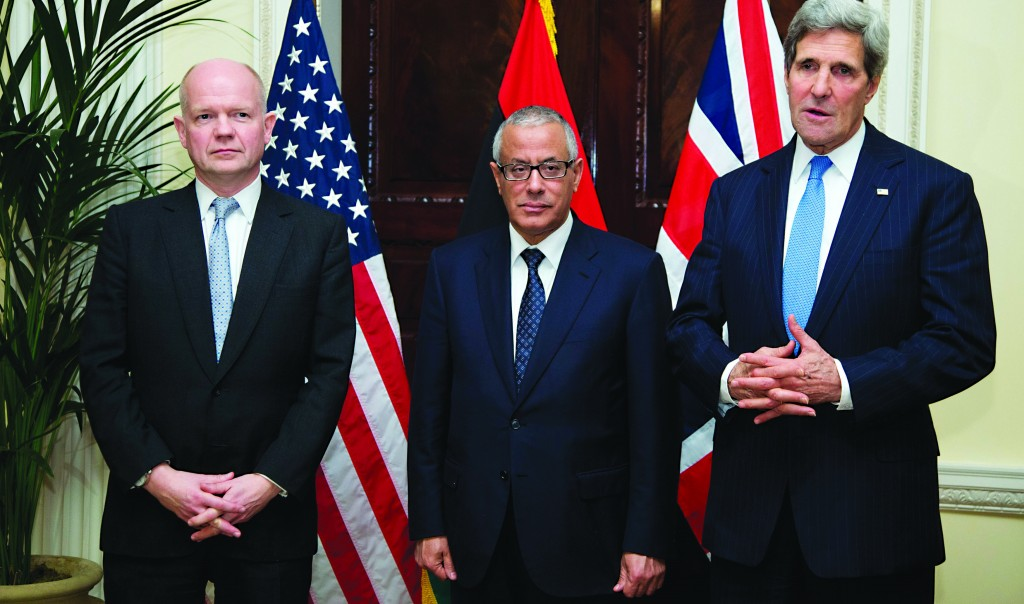 U.S. Secretary of State John Kerry (R) speaks to the media as British Foreign Secretary William Hague (L) and Libyan Prime Minister Ali Zeidan stand alongside him at the Winfield House, the residence of the U.S. Ambassador to Britain, in London, on Sunday. Kerry arrived to meet British and Libyan officials after taking part in the talks curbing Iran's nuclear activity. (REUTERS/Carolyn Kaster/Pool)