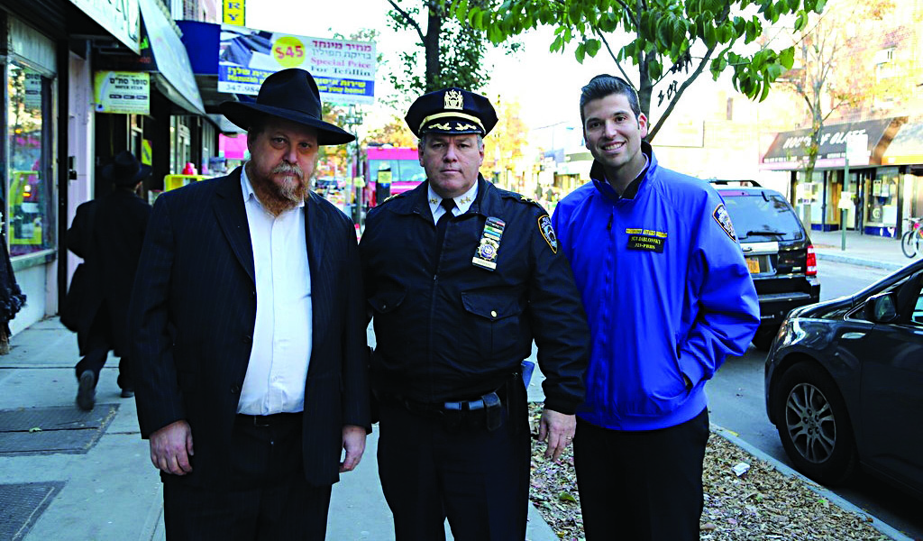 Assistant Chief Owen Monaghan, the commanding officer of Brooklyn South, walks on Crown Heights's Kingston Ave. Friday with Rabbi Chanina Sperlin (L), executive vice president of the Crown Heights JCC. (Itzik Roytman/COLlive.com)