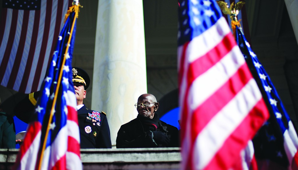 World War II veteran, 107 year-old Richard Overton, from East Austin, Texas, stands up for the presentation of the colors during Veteran Day ceremony in the Arlington National Cemetery Amphitheater, at Arlington National Cemetery in Arlington, Va., Monday. (AP Photo/Pablo Martinez Monsivais)