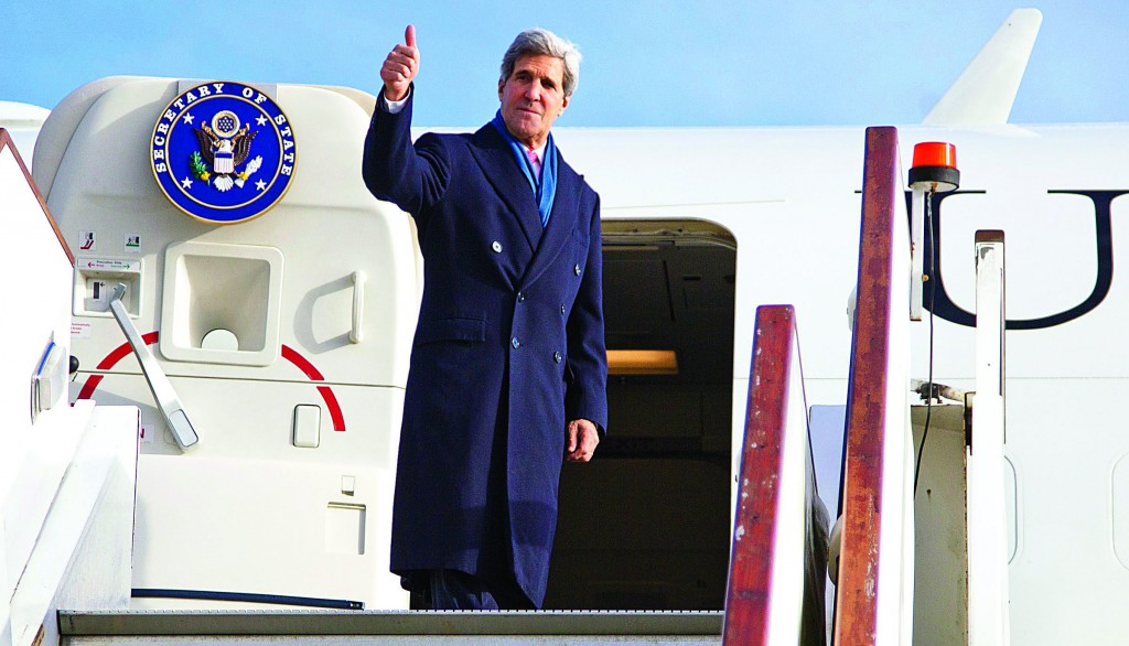 Secretary of State John Kerry gives the thumbs-up as he boards his aircraft at London's Stansted Airport Monday, en route to Washington. While in London Kerry had meetings with Libyan Prime Minister Ali Zeidan and British Foreign Secretary William Hague. (REUTERS/Carolyn Kaster/Pool)
