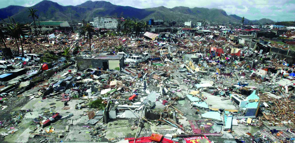 Thousands of homes were destroyed near the fishport after Super Typhoon Haiyan battered Tacloban city, in central Philippines. (REUTERS/Romeo Ranoco)