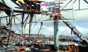 Debris hang on a basketball post near thousands of houses damaged after super Typhoon Haiyan battered Tacloban city, in central Philippines. (REUTERS/Romeo Ranoco)