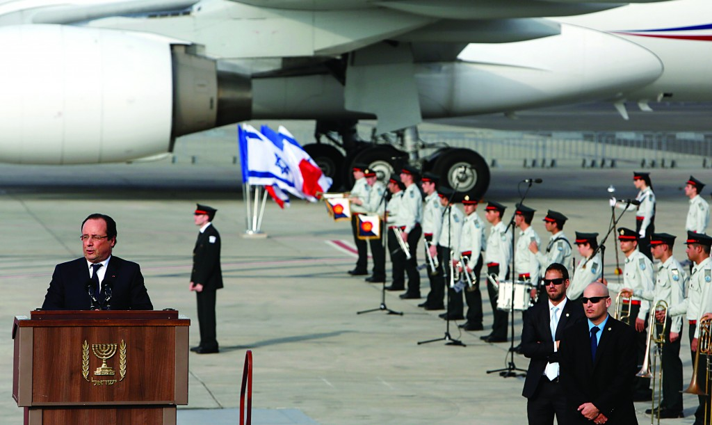 French President Francois Hollande speaks at a welcoming ceremony attended by Israeli Prime Minister Binyamin Netanyahu and Israeli President Shimon Peres at Ben-Gurion International Airport on Sunday. (Miriam Alster/FLASH90)