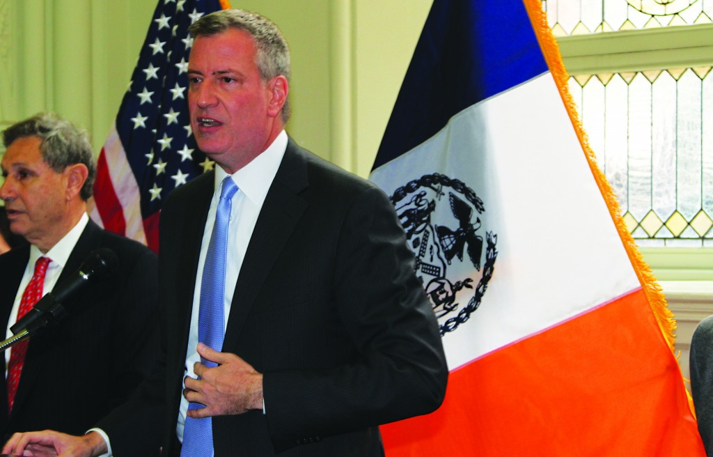(L) Mr. Carl Weisbrod, co-chair transition team. (R) Bill de Blasio giving his first major press conference, Wednesday. (Shimon Golding)