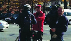 Curtis Sliwa (C), founder of the Guardian Angels, talks to a biker on Ocean Parkway last week as his group vows to protect Jews from knockouts. (News Breakers)