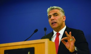 Finance Minister Yair Lapid speaks at a press conference Monday night. (Yonatan Sindel/Flash90)