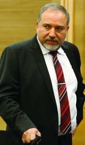 Former Foreign Minister Avigdor Lieberman may be forced to vacate his seat for some time. Lieberman seen here during a meeting of the Likud-Beitenu faction in the Knesset on Monday. (Flash90)