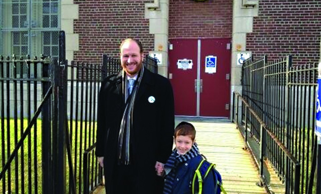 Councilman David Greenfield emerges from his Midwood polling station on Tuesday morning, his young son in tow. (Jacob Kornbluh)