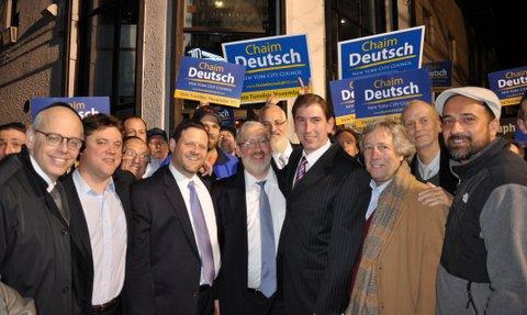 Chaim Deutsch at his election night party surrounded by supporters. (Chaskel Bennett)