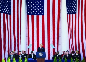 President Barack Obama speaks in the Memorial Amphitheater at Arlington National Cemetery in Arlington, Va., Monday, during a ceremony commemorating Veterans Day. (AP Photo/Manuel Balce Ceneta)