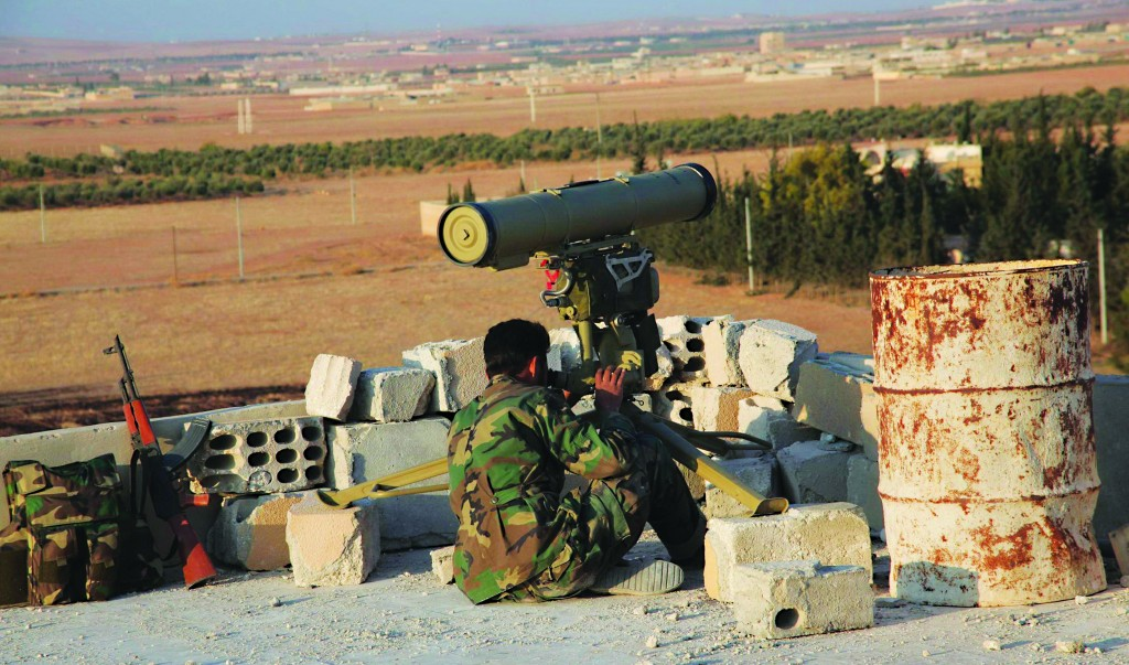 A soldier loyal to Syria's President Bashar al-Assad looks through the scope of his weapon in the countryside outside Aleppo. Syrian forces, backed by Hizbullah, recaptured all the factories on the main road between the town of Safira and Aleppo, they said. (REUTERS/George Ourfalian)