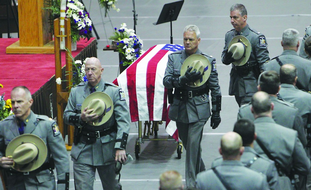 State troopers pass the casket bearing Trooper Ross M. Riley in Olean, N.Y., Tuesday. (AP Photo/Buffalo News, Sharon Cantillon)