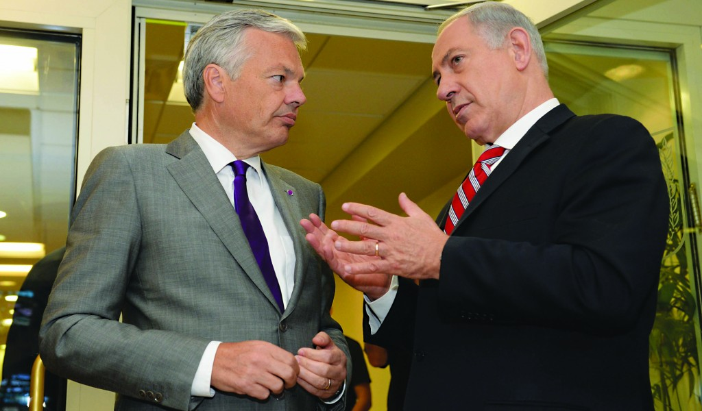 Israeli Prime Minister Binyamin Netanyahu (R) meets with Belgian Minister of Foreign Affairs Didier Reynder in Yerushalayim on Monday. At a joint press conference, Netanyahu reaffirmed the U.S.-Israel alliance despite tensions over Iran. (Kobi Gideon /GPO/FLASH90)