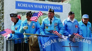 Members of the Central Long Island, N.Y., chapter of the Korean War Veterans ride a float in the Veterans Day Parade on New York's Fifth Avenue, Monday.