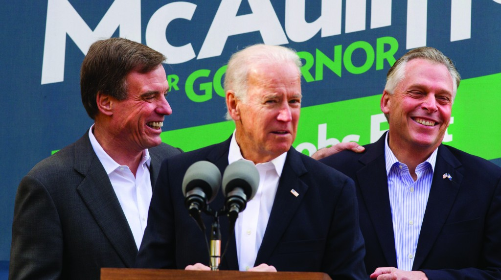 Vice President Joe Biden (C) accompanied by Sen. Mark Warner, D-Va. (L) speaks at a campaign event for Virginia Democratic gubernatorial candidate Terry McAuliffe (R) Monday, Nov. 4, 2013, in Annandale, Va. On Tuesday, Virginia voters chose McAuliffe over Ken Cuccinelli for the next governor. (AP Photo/Jacquelyn Martin)