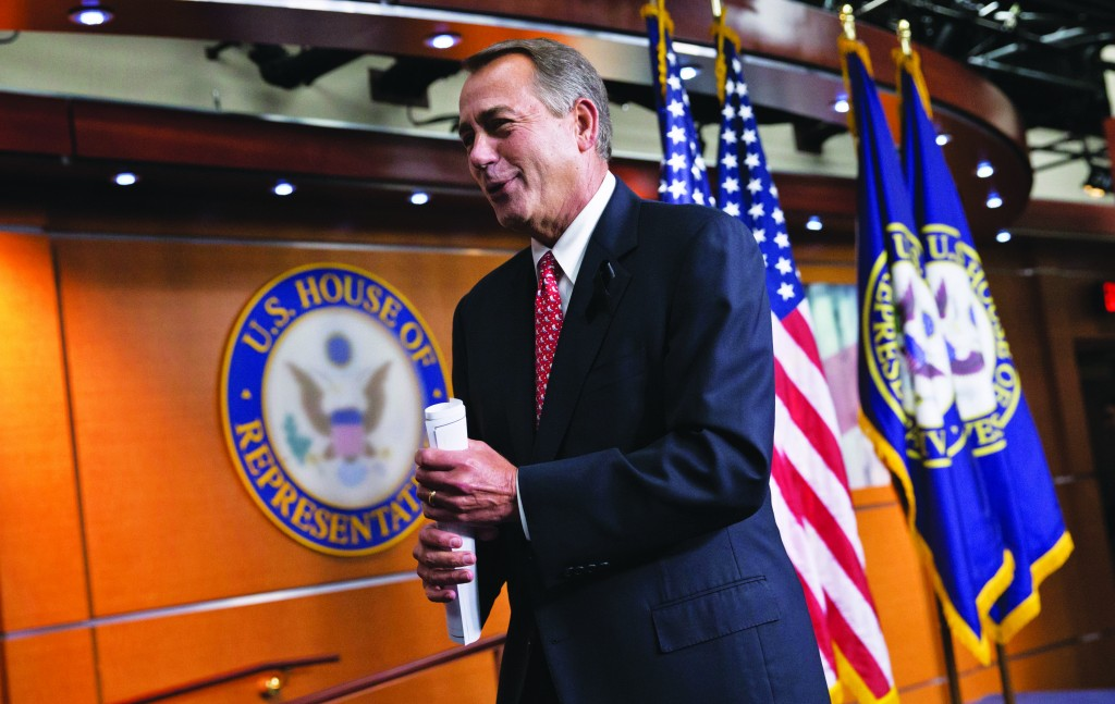 House Speaker John Boehner of Ohio leaves a news conference on Capitol Hill in Washington, Thursday, where he rebuked conservative groups who opposed the bipartisan budget compromise. (AP Photo/J. Scott Applewhite)