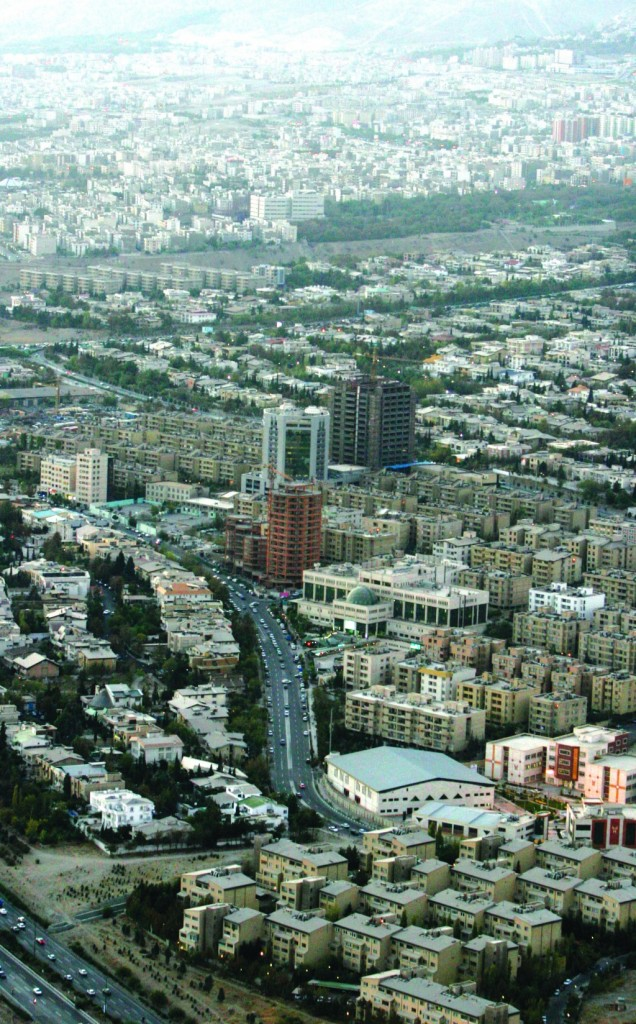 An aerial view of Tehran is seen from the top of the Milad telecommunication tower, in Tehran, Iran. The Iranian parliament voted Tuesday to consider a proposal to pick another city as the nation's capital, potentially moving the seat of government from the overcrowded and heavily polluted city of Tehran despite government opposition to the plan. (AP Photo/Vahid Salemi-File)
