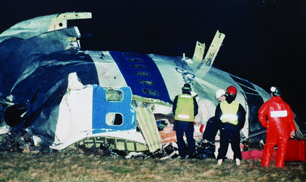 In this Dec. 21, 1988 photo, rescue workers examine the nose of Pan Am Flight 103 near the town of Lockerbie, Scotland, after a bomb aboard exploded, killing a total of 270 people. (AP Photo/Martin Cleaver, File)