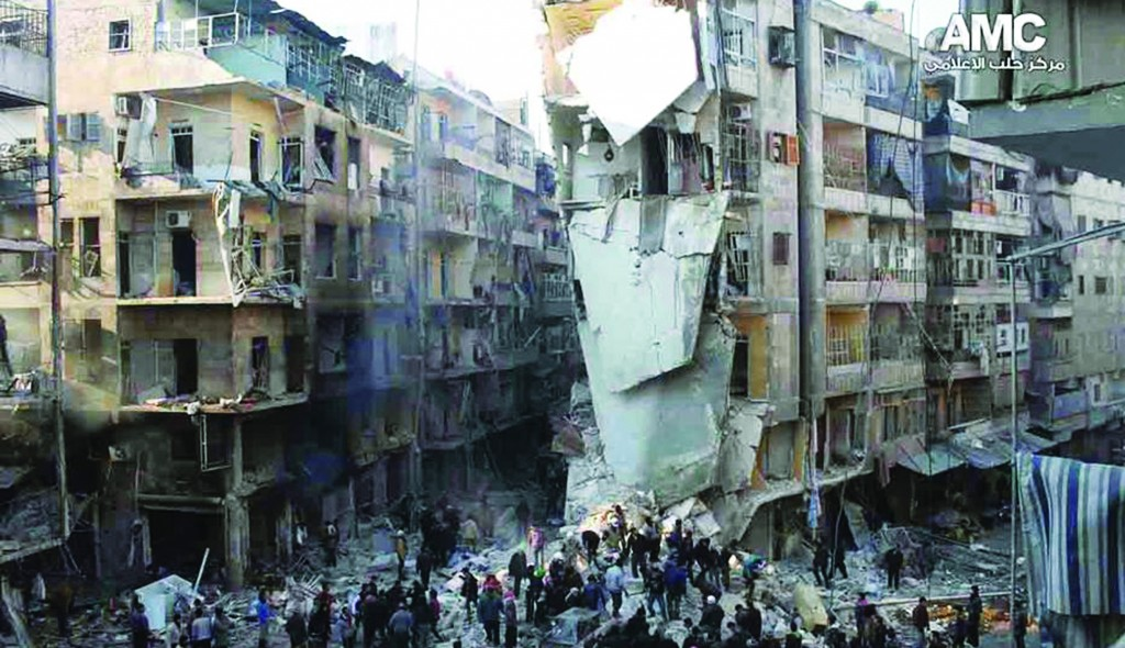 In this citizen journalism image provided by Aleppo Media Center, AMC, Syrians inspect the rubble of damaged buildings following a Syrian government airstrike in Aleppo, Syria. (AP Photo/Aleppo Media Center, AMC)