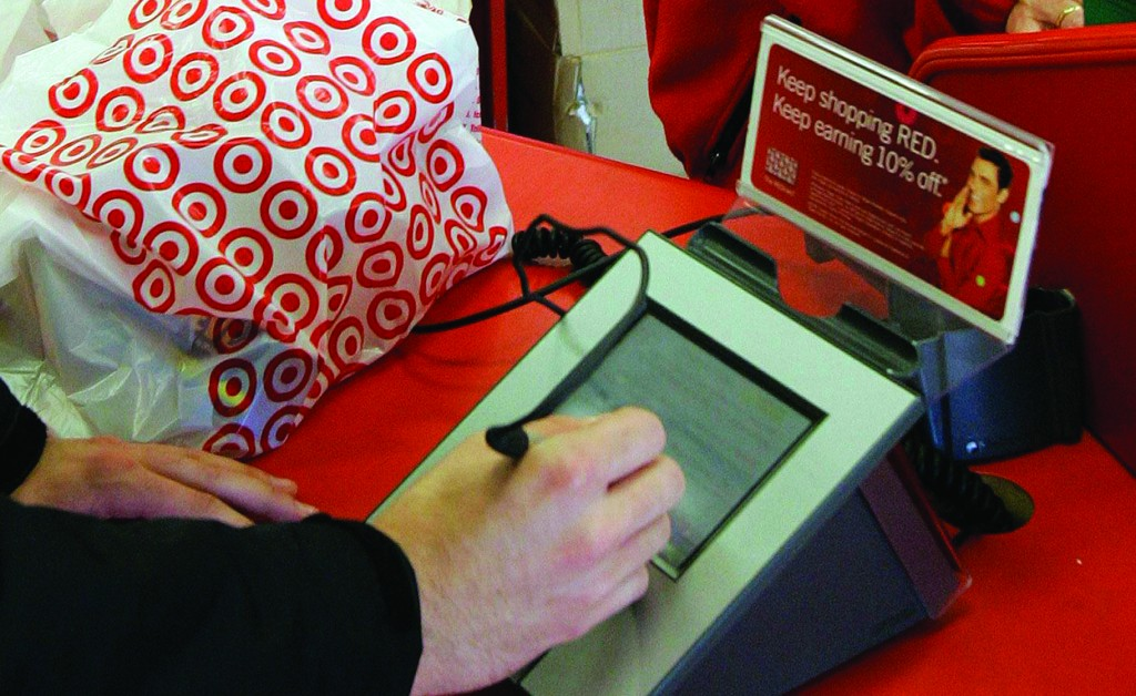 A customer signs his credit card receipt at a Target store in Tallahassee, Fla. (AP Photo/Phil Coale, File)