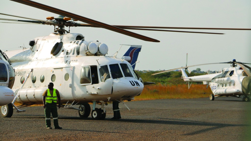 In this photo released by the United Nations Mission in South Sudan (UNMISS), a U.N. helicopter transporting wounded civilians from Bor, the capital of Jonglei state and said to be the scene of fierce clashes between government troops and rebels, arrives at the airport in Juba, South Sudan. (AP Photo/UNMISS)