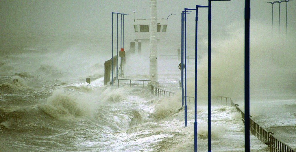 Waves batter the North Sea coast at the ferry dock in Dagebuell, northern Germany, Thursday. (AP Photo/dpa, Carsten Rehder)