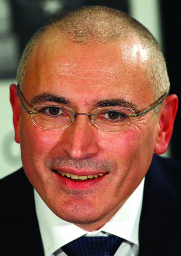 Mikhail Khodorkovsky smiles during his news conference in Berlin on Sunday. (AP Photo/Michael Sohn)