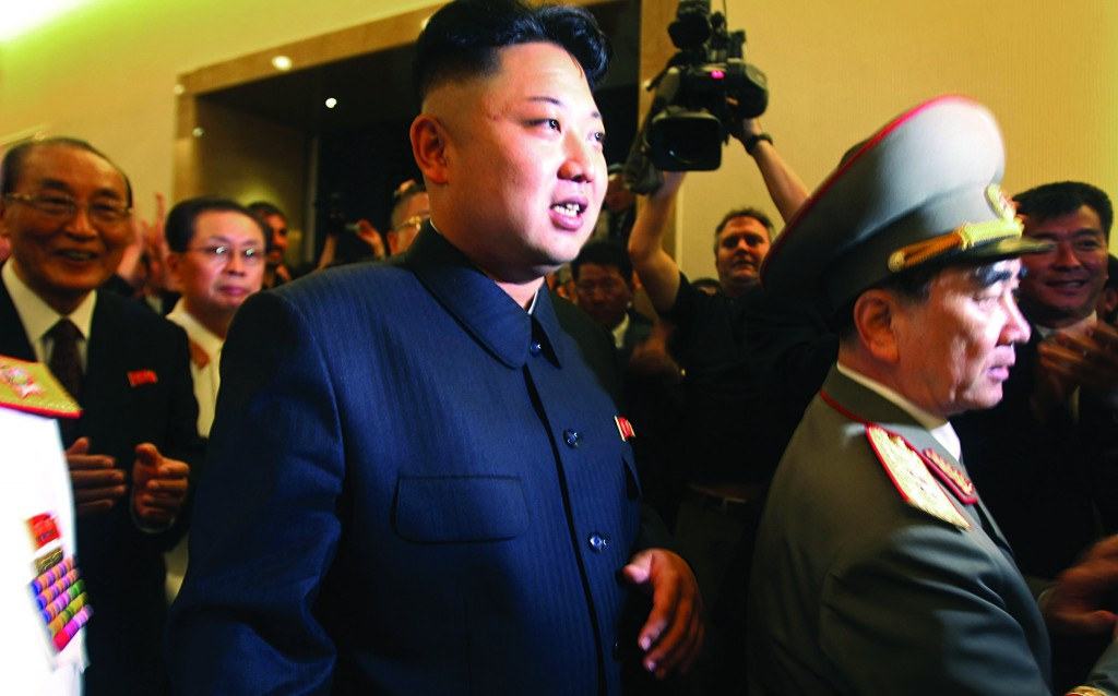 In this July 27, 2013, file photo, North Korean leader Kim Jong Un (C) is followed by his uncle Jang Song Thaek (2nd L) and Yang Hyong Sop (L), vice president of the Presidium of North Korea's parliament, as he tours the newly opened Fatherland Liberation War Museum as part of celebrations for the 60th anniversary of the Korean War armistice in Pyongyang, North Korea. (AP Photo/Wong Maye-E, File)