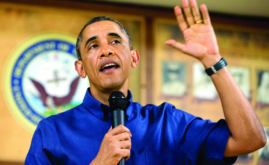 President Barack Obama speaks to members of the military and their families in Anderson Hall at Marine Corps Base Hawaii, in Kaneohe Bay, Hawaii. (AP Photo/Carolyn Kaster)