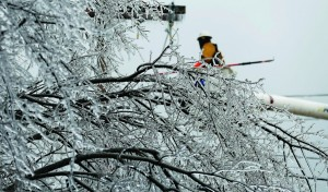 Josh Mason, a lineman with Southern Electric Corp., in Flowood, Miss., fuses switches on power lines, near 81st Street and Union Avenue, as crews fix electric lines caused by a recent ice storm, in Tulsa, Okla. (AP Photo/Tulsa World, Cory Young)