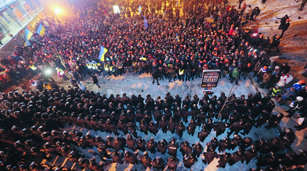 Ukrainian riot police block pro-European Union activists in Independence Square in Kiev, Ukraine, Wednesday. (AP Photo/Efrem Lukatsky)