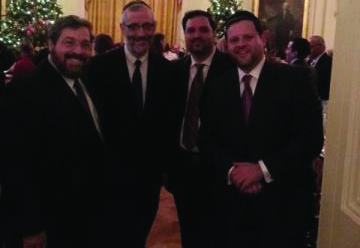 Rabbi Abba Cohen, Rabbi Chaim Dovid Zweibel, Mr. Shea Rubenstein, Mr. Chaskel Bennett at White House Chanukah party Thursday. (Chaskel Bennett)