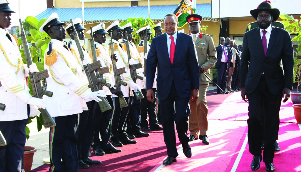 President Uhuru Kenyatta (L) and South Sudan President Silva Kiir (R) inspect a guard of honor when the Kenyan president arrived in Juba for peace talks, in South Sudan on Thursday. (AP Photo/Kenyan Presidential Press Service)