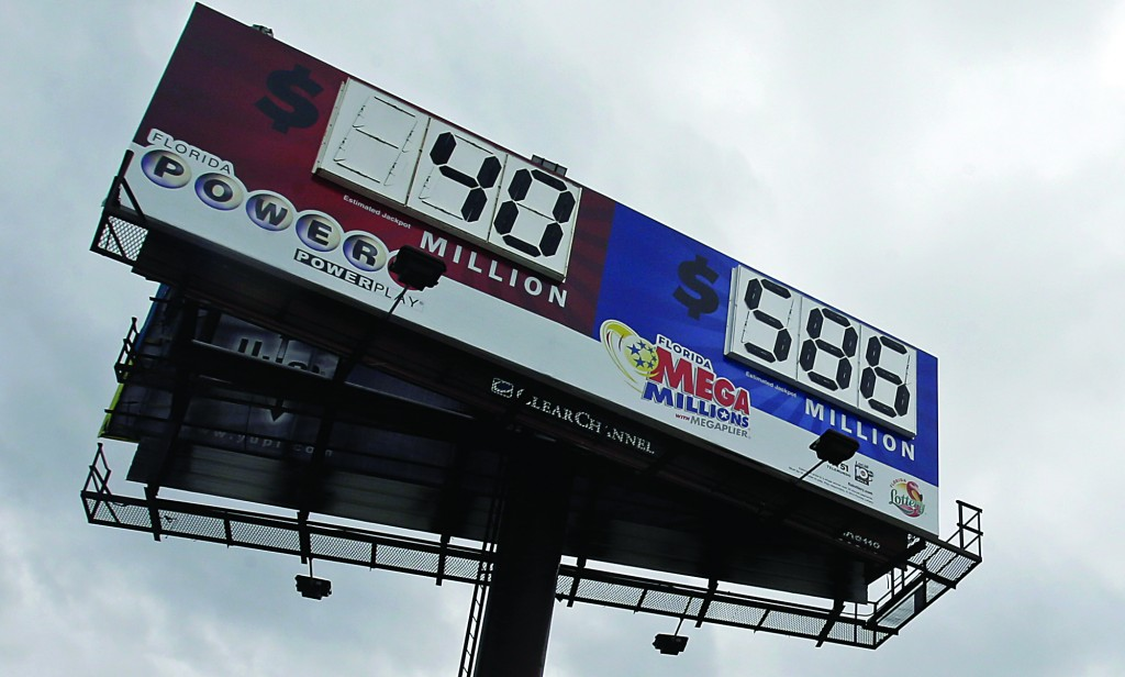 A billboard shows the jackpot for Powerball and the Mega Millions prize-winning tickets Monday, Monday, in Hialeah, Fla. (AP Photo/Alan Diaz)