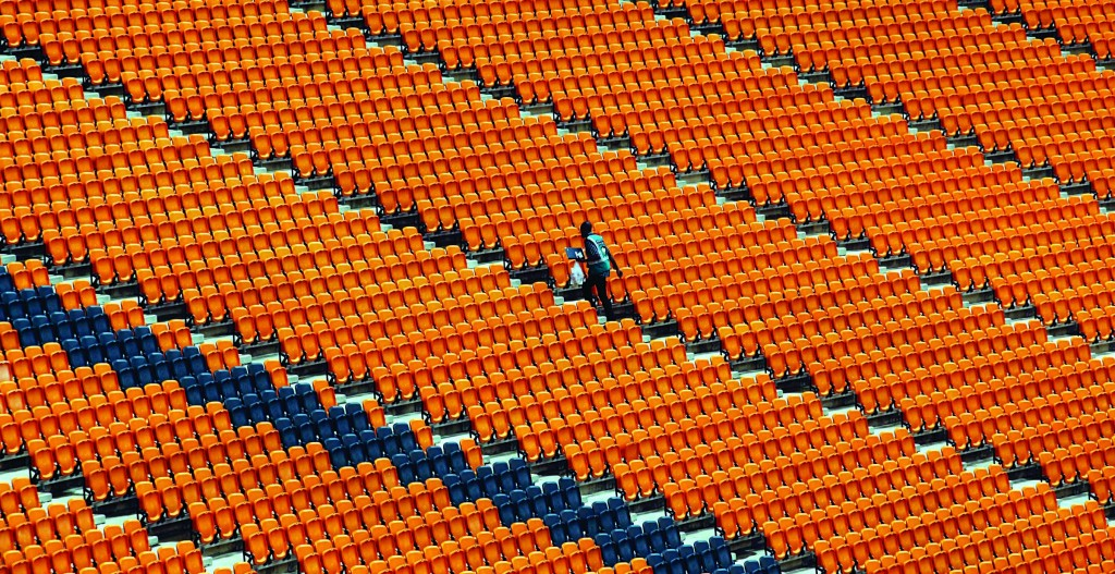 A worker walks in the stands at the FNB Stadium on the edge of Soweto, South Africa, Sunday, ahead of Tuesday's memorial service for Nelson Mandela, who passed away last Thursday after a long illness at 95. (AP Photo/Denis Farrell)