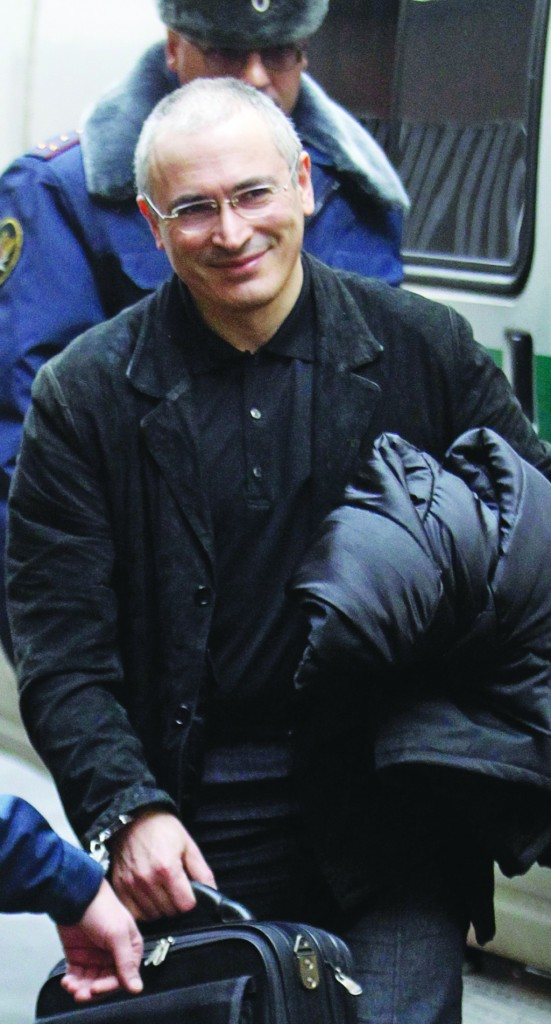 In this 2010 file photo former Yukos CEO Mikhail Khodorkovsky is escorted to a court in Moscow, Russia. Russian President Vladimir Putin said on Thursday that he will pardon his arch-enemy Khodorkovsky. (AP File Photo/Sergey Ponomarev)