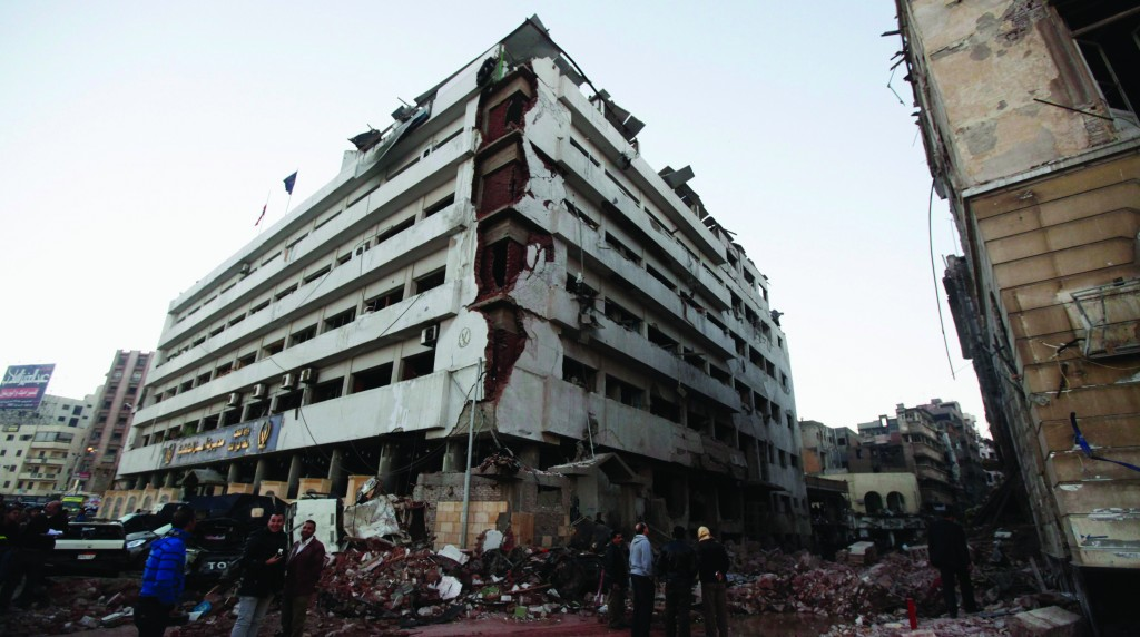 The building of the Directorate of Security is pictured after an explosion in Egypt's Nile Delta town of Dakahlyia, 75 miles northeast of Cairo, Tuesday. (REUTERS/Mohamed Abd El Ghany)