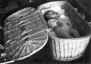 An infant (illegal immigrant) en route from Haifa to a detention camp.